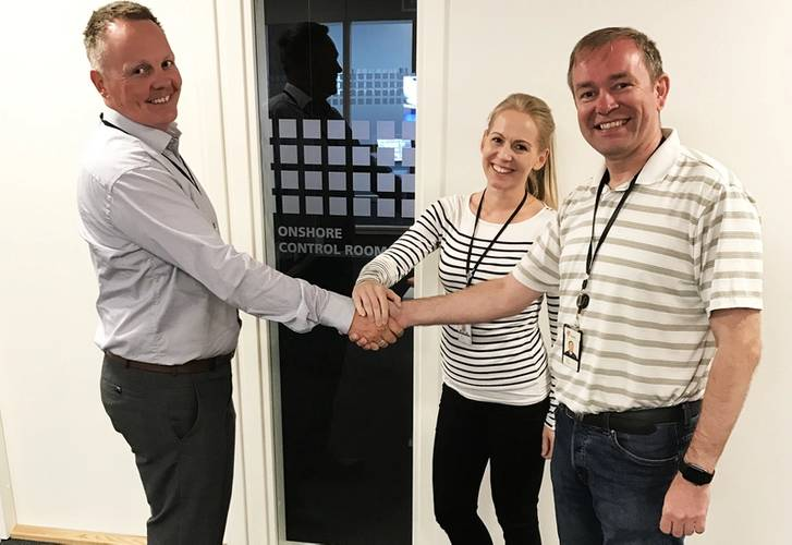 Pictured is Statoil company  representative for ROV service agreements; Trond Eriksen and Snorre B  Subsea engineer; Silje Ramvik together with IKM Subsea's Operations Director; Jan Vegard Hestnes outside one of the Onshore Control Rooms after signing the CAT.. (Photo: IKM Subsea)