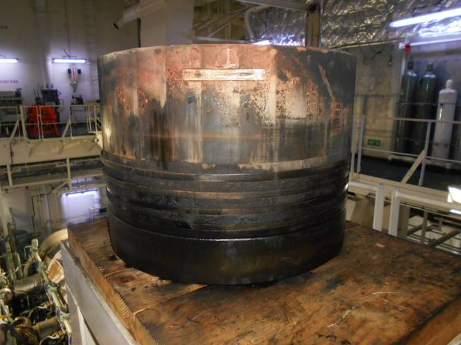 Piston with scuffing and deposits. Photo courstesy Chevron