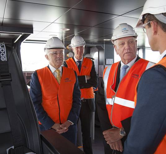 Prime Minister Malcolm Turnbull, Austal CEO David Singleton and Austal Chairman John Rothwell learn more about the 72m High Speed Support Vessel (HSSV) from HSSV Program Manager Mark Clay. (Image: Rod Taylor/Austal)