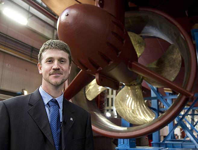 Project Manager, Oscar Kallerdahl stand beneath the second LNG tug, which will be delivered early next year.