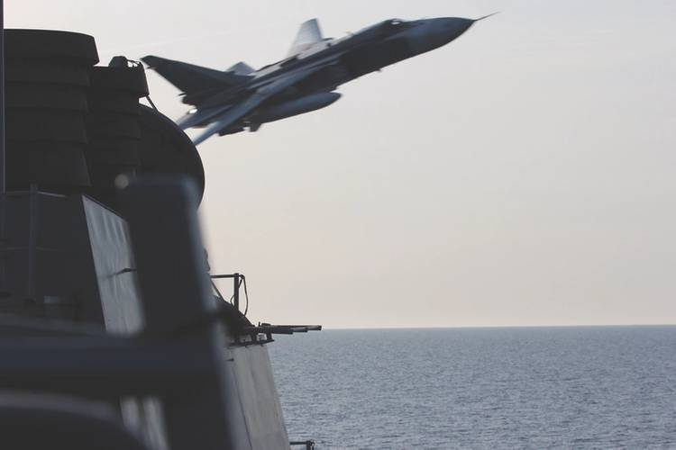 Provocative Fly By. A Russian Sukhoi Su-24 attack aircraft makes a very low altitude pass by USS Donald Cook (DDG 75) April 12, 2016. Donald Cook, an Arleigh Burke-class guided-missile destroyer forward deployed to Rota, Spain, is conducting a routine patrol in the U.S. 6th Fleet area of operations in support of U.S. national security interests in Europe. (U.S. Navy photo)