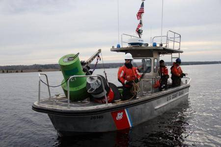 Recovering buoys before winterMembers of Coast Guard Station Portage, Mich., aboard a 26-foot Trailerable Aids to Navigation Boat, prepare to transit back to the station after recovering several buoys before Lake Superior freezes, Nov. 14, 2013. One of the station's missions is aids to navigation. (U.S. Coast Guard photo by Petty Officer 1st Class Thomas Johnson)