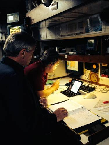 Robert Scott, ARES Security Corporation, and Pride of Baltimore's Captain Jan Miles in Pride of Baltimore's navigation center reviewing CommandPost capabilities. (PRNewsFoto/The Mariner Group)