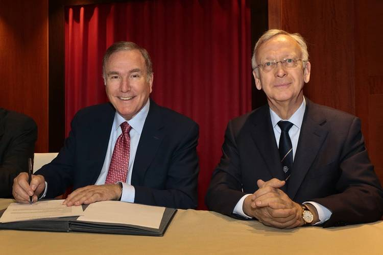Royal Caribbean Cruises Ltd.'s Chairman and CEO Richard D. Fain, left, officially received the new ship from Meyer Werft Yard's Managing Partner Bernard Meyer, right, in a signing ceremony held in Bremerhaven, Germany. (Photo: Royal Caribbean)
