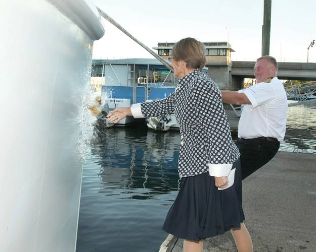 R/V Spirit of the Sound christened by her godmother Astrid Heidenreich on Friday, September 26, 2014. She is assisted by boat build project manager Robert Kunkel, Amtech.