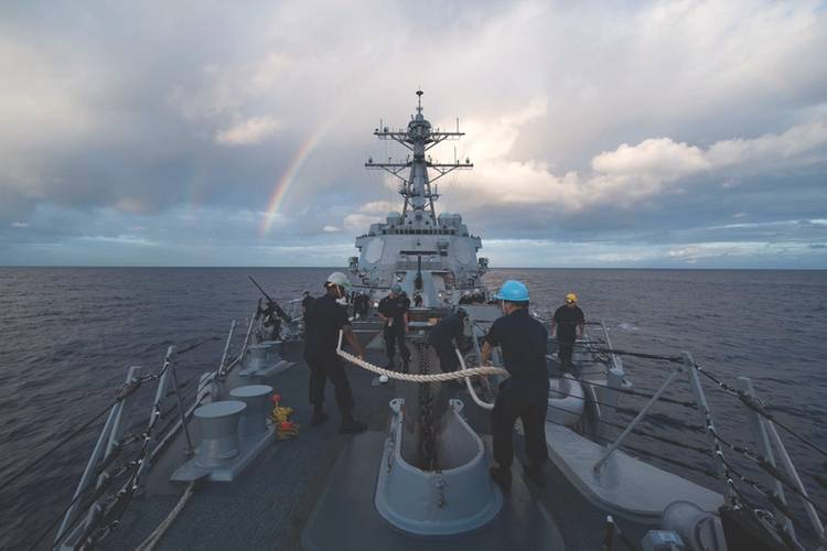 sailors aboard the arleigh burke class guided missile destroyer uss michael murphy us