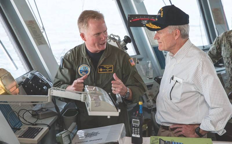 Secretary of the Navy Richard V. Spencer speaks with Capt. Richard McCormack, commanding officer of the aircraft carrier USS Gerald R. Ford (CVN 78), during a tour of the ship. (U.S. Navy photo)