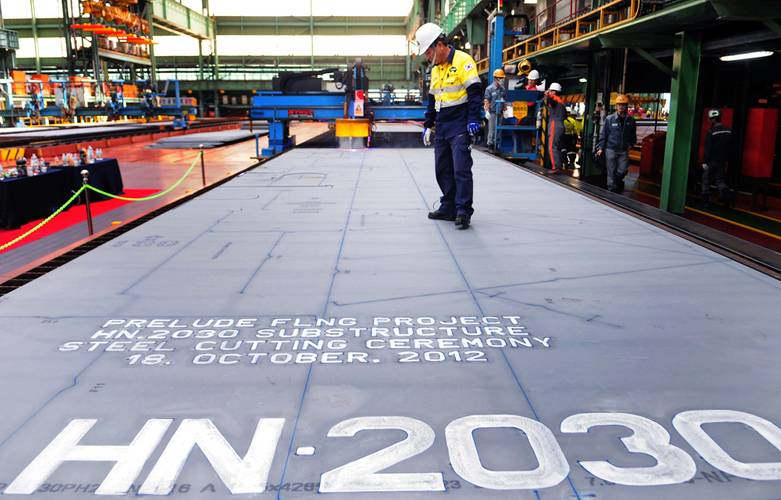 Shell celebrates the first steel cut for the first steel cut for the game-changing Prelude floating liquefied natural gas project's substructure. The sheet of steel to be cut weighs 7.6 tonnes, is 4.3 metres wide, 13.8 metres long and 16.5 millimetres thick. (Photo: Shell)
