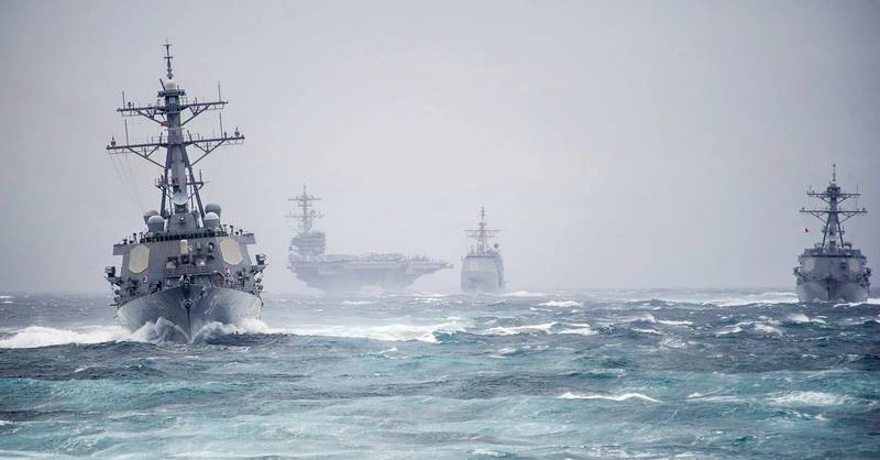 Ships from the George H.W. Bush Carrier Strike Group simulate a strait transit in the Atlantic Ocean, Dec. 10, 2013. The strike group was conducting a pre-deployment evaluation. (U.S. Navy Photo by Justin Wolpert)