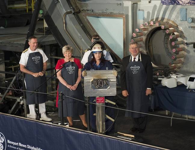 Ship's sponsor Diane Donald shows her initials during a keel laying ceremony for the future Virginia-class attack submarine Indiana (SSN 789). (U.S. Navy photo courtesy of Huntington Ingalls Industries by Ricky Thompson)