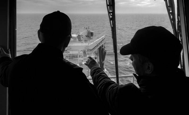 Spencer Fraiser (right), the CEO of NRU Asterix, and Commodore Craig Skjerpen (left) , Commander of Canadian Fleet Atlantic , on the Bridge of the NRU Asterix off the Coast of Halifax, Nova Scotia on Jan 12, 2018. (Photo: John Iglesias / Formation Imaging Services)