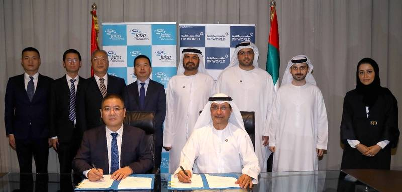 Sultan Ahmed Bin Sulayem, DP World Group Chairman and CEO,  Mohammed Al Muallem, CEO and Managing Director, DP World, UAE Region and Zhao Wenge, Group Chairman, CCC Group during the signing ceremony at JAFZA. Photo: DP World