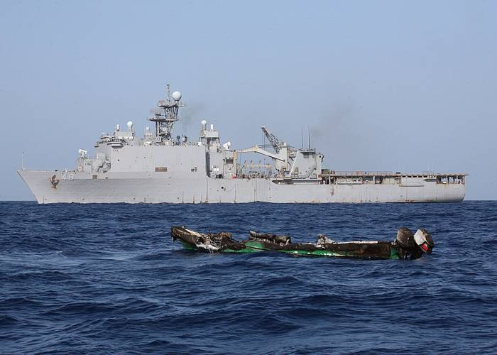 Suspected pirates skiff burns after being burnt near the amphibious dock landing ship USS Ashland in 2010. (U.S. Navy photo/ Harry J. Storms)