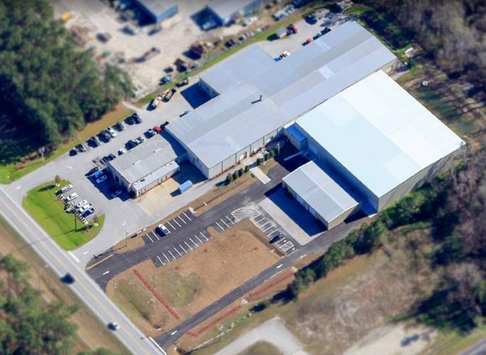 Tandemloc moved from New York to Havelock, NC, in 1992. because they received a deal they could not refuse: rent of $1 per month on a 5,000 sq. ft. building. Since then Tandemloc has expanded several times and now it owns more than 100,000 sq. ft. of space on 12 acres of land. Photo: Tandemloc.