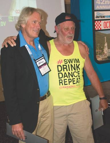 "The attendees were delighted with the good-humored sparring of two Australian heavy weights of the ferry world: Austal's Mike Wake and Incat's Bob Clifford. Clifford, an icon of the industry and dressed in casual Aussie attire, made the case for the efficiency of ""two long skinny hulls"" while Wake, with an impressive video, argued for the sea kindliness of a third central hull. (Photo: Alan Haig-Brown)"