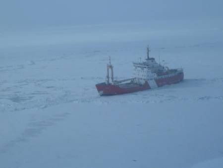 The Canadian Coast Guard Ship Griffon, a 234-foot multi-mission medium icebreaker, breaks ice in Lake Erie en route to a rendezvous with the U.S. Coast Guard Cutter Bristol Bay. The Griffon will assist the Bristol Bay into Cleveland Harbor before making way to assist the motor vessel Arthur M. Anderson. (Photo courtesy of Canadian Coast Guard)