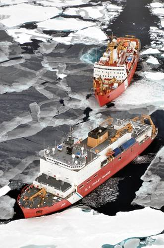 The Canadian Coast Guard Ship Louis S. St-Laurent makes an approach to the Coast Guard Cutter Healy in the Arctic Ocean. Credit: USCG Photo, Patrick Kelley, Photographer to the Commandant