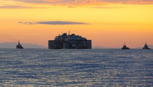 The Costa Concordia wreckage in tow (Photo courtesy of the Parbuckling Project)