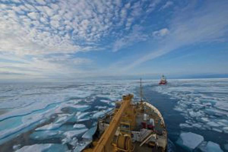 The crew of oceangoing buoy tender U.S. Coast Guard Cutter Maple follows the crew of Canadian Coast Guard Icebreaker Terry Fox through the icy waters of Franklin Strait, in Nunavut Canada, August 11, 2017.  U.S. Coast Guard photo by Petty Officer 2nd Class Nate Littlejohn.