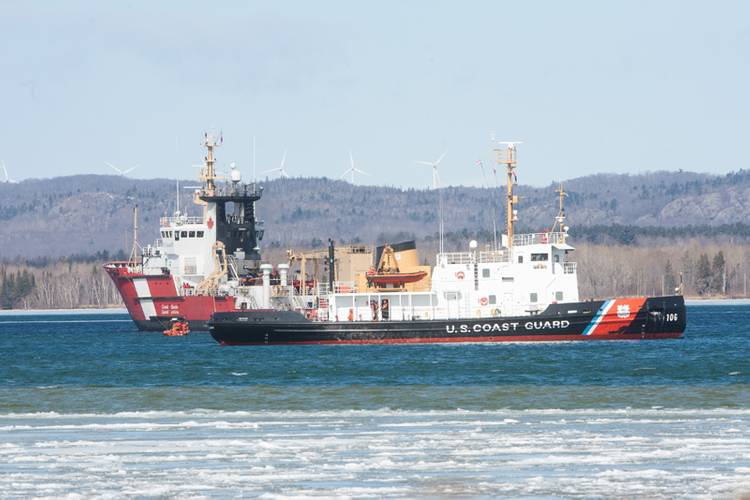 The crew of the Canadian Coast Guard Ship Samuel Risley rendezvoused with the crew of USCGC Morro Bay on the St. Mary's River near Sault. Ste. Marie Ontario, Monday March 21 2016. (Photo credit: Fisheries and Oceans Canada)