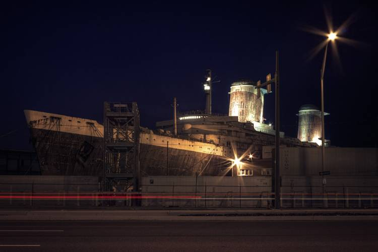 "The funnels, bridge, and radar mast of the SS United States lit for the Conservancy's ""National Flagship Celebration"", July 1, 2010. The light installation was done by artist Robert Wogan. (Credit: SS United States Conservancy)"