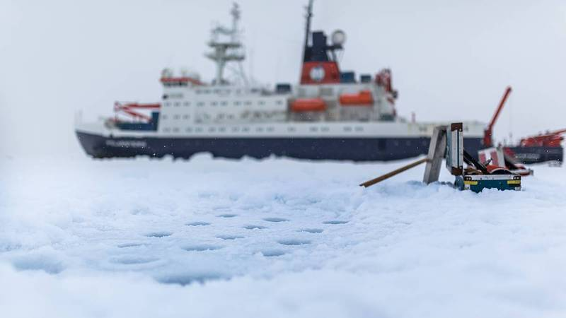 The German research vessel Polarstern during an ice station. View of drilled holes for taking out ice cores and water samples from the arctic sea ice. (Photo Stefan Hendricks/ AWI)
