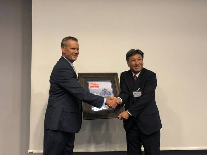 """The JSMEA/Maritime Reporter reception on Tuesday, September 4, was the perfect opportunity to present Yoshikazu Kawagoe, Chief Technical Officer, Mistui O.S.K. Lines, with a framed cover of Maritime Reporter's December 2017 cover feature MOL's FSRU Challenger, the 2017 """"Great Ship of the Year."""" (Photo: Rob Howard)"""