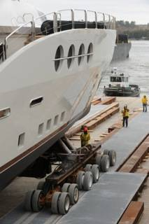 The maneuverability of Holland Dollies – both coaster and powered – made it possible for a team from Atlas Enterprises to safely move this superyacht, which is large enough to be classified as an oceanliner, from its fabrication facility and through city streets to water for sea trials.
