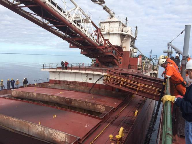 The motor vessel Phillip R. Clarke receives taconite by conveyor belt from the motor vessel Roger Blough that ran aground on May 27, near Gros Cap Reefs Light in Lake Superior, June 3, 2016. The Clarke is scheduled to remove some of the taconite from the Blough in order to lighten the Blough so it can be refloated. (U.S. Coast Guard photo by Kyle Schmidt)