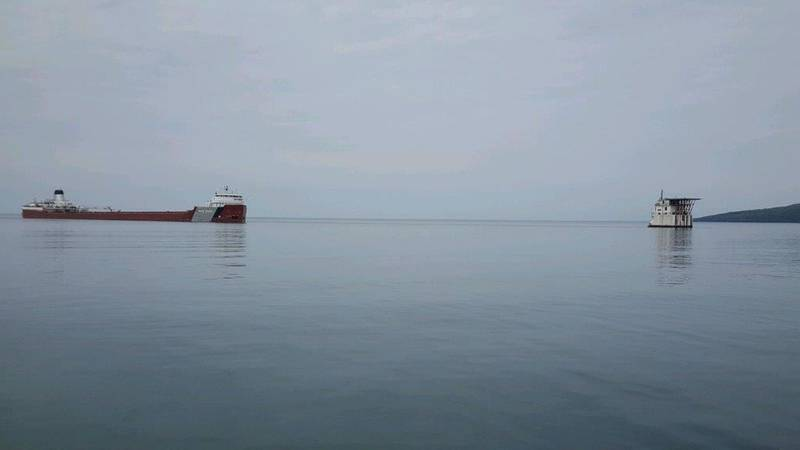 The motor vessel Roger Blough sits grounded just off of Gros Cap Reefs Light in Whitefish Bay, Lake Superior, May 27, 2016. (U.S. Coast Guard photo by Samantha Coonan)