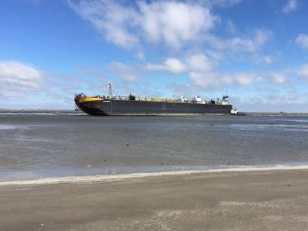 The tugboat, Peter F Gellatly and barge, Double Skin 504, sit grounded near East Beach after high winds pushed it from Bolivar Roads Anchorage, Sunday, Oct. 25, 2015. (U.S. Coast Guard photo by Cmdr. Ricardo Alonso)