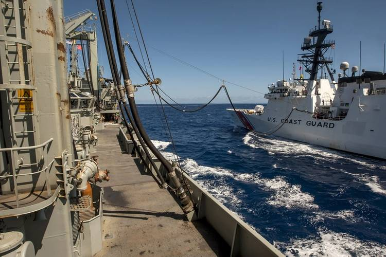 The US Coast Guard Cutter USCGC Waesche takes on fuel from HMAS Success as the Australian ship conducts a dual RAS (Replenishment at Sea) (Photo: Brenton Freind)