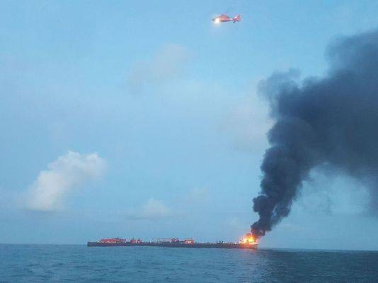 The U.S. Coast Guard responds to barge on fire approximately three miles from Port Aransas, Texas. (U.S. Coast Guard phot)