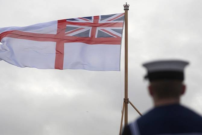 The White Ensign was raised, symbolizing the commissioning of the nation's future flagship into the Royal Navy's fleet. (Photo: Royal Navy)