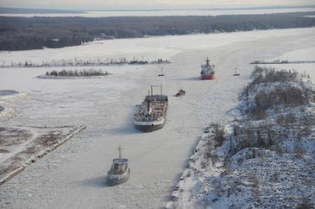 U.S. Coast Guard cutters Biscayne Bay and Mackinaw break ice on the St. Mary's River in Mich. U.S. Coast Guard photo by Chief Petty Officer David Rauch.