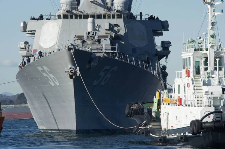 USS John S. McCain is lowered into the water from the heavy lift transport MV Treasure. (U. S. Navy photo by William McCann)