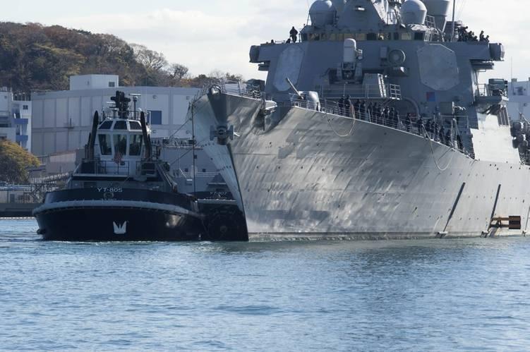 USS John S. McCain is towed to a pier at Fleet Activities (FLEACT) Yokosuka. (U. S. Navy photo by William McCann)