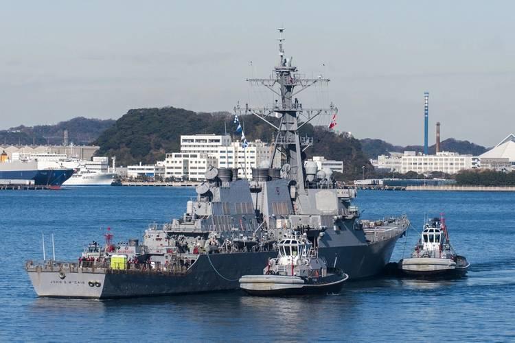 USS John S. McCain is towed to a pier at Fleet Activities (FLEACT) Yokosuka. (U. S. Navy photo by Leonard Adams Jr.)