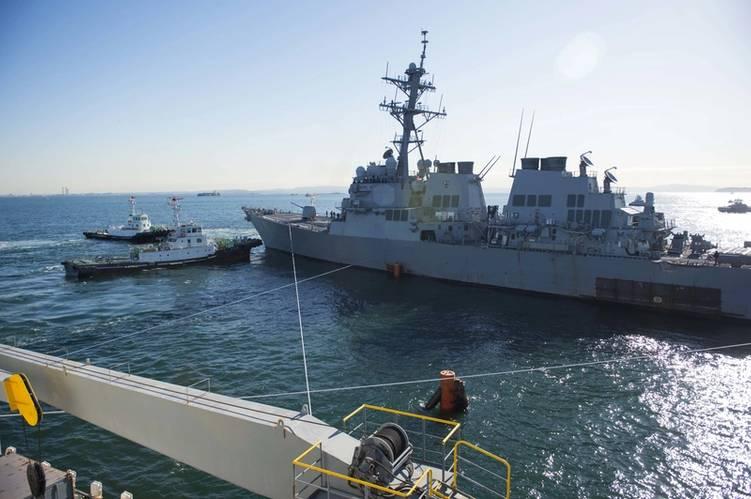 USS John S. McCain is towed from the heavy lift transport MV Treasure. (U. S. Navy photo by Joshua B. Mortensen)
