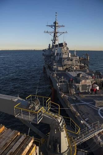 USS John S. McCain is towed by the heavy lift transport MV Treasure. (U. S. Navy photo by Joshua B. Mortensen)