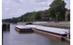 (A Barge at Starved Rock. An average of 16 million tons of soybeans move through locks on the Illinois Waterway each year. While much needed repairs are underway, Illinois farmers will need to navigate lock closures in 2019, 2020 and 2023.) CREDIT: Illinois Soybean Association